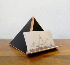 This handmade business card holder is a unique and stylish way to hold your business cards on your desk at work or display them at a craft fair or