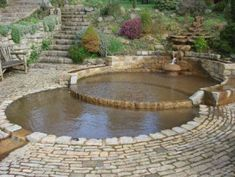 Fountain - what about a shallow, circular stone wading pool - easy to clean and fill in the summer?