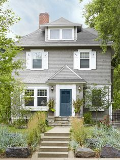 This home's gray exterior is both cedar shakes and siding. The texture and moon-shutters make it a standout on the block. #curbappeal #hgtvmagazine http://www.hgtv.com/landscaping/curb-appeal-across-the-country/pictures/page-54.html?soc=pinterest