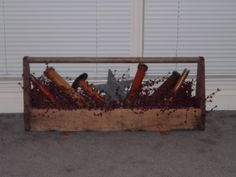 Old tool box  filled with pip berries and old wooden bobbins/spools.  Bill's big ole tool box. I may try this.