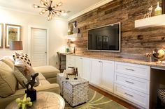 A reclaimed wood accent wall and built-in desks elevate the design of this… Reclaimed Wood Accent Wall, Living Room Shelves, Built In Desk, Kids Room, Kitchen Cabinets, Kitchen Cabinetry, Room Kids, Kids Rooms Decor, Kid Rooms