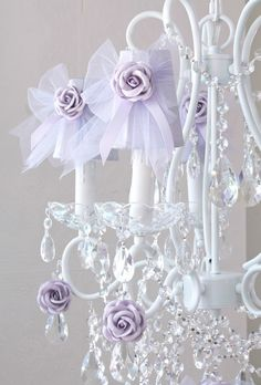 """This adorable Lavender Dupioni Silk shade is decorated with a dreamy Tulle bow, delicate satin ribbons and a sweet rose. Each clip-on shade measures 3.5"""" at the bottom opening, 2.1/4"""" at the top opening and 4"""" tall. The price indicated is for ONE SHADE, you may purchase as many as you need.  These shades are a perfect addition to any chandelier, wall sconce or candelabra and can be clipped onto any regular chandelier bulb. Please use with 25 or 40 watts bulbs only!  Please ..."""
