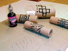 need puffy paint now! and now i can use those school paper towel rolls when they're empty, cut them into 3's. SO doing this.