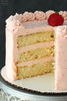 This Strawberry Moscato Layer Cake is made with layers of moscato cake and strawberry buttercream. It's moist and super fun way to drink your wine - and eat it too.