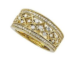 14K Yellow Gold Diamond Band.    http://www.thediamondstore.com/products/diamond-and-fashion-color-rings/14k-yellow-gold-diamond-band/16-943