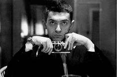 Self-portrait of Stanley Kubrick with a Leica III camera.