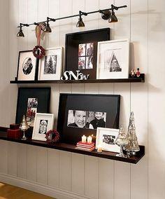 Wall shelves with framed art - I like the lights