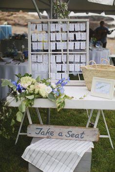 shabby chic blue and white escort card table  http://www.weddingchicks.com/2013/12/11/seaside-wedding-2/