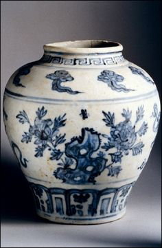 Blue and white china vase with Greek motifs, frieze alternating cloud and peony.