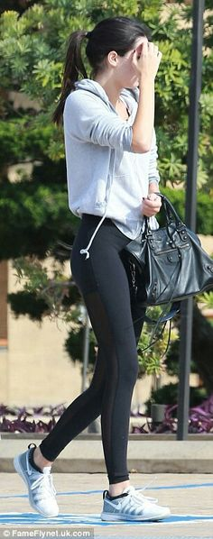 Sheer thing: The 19-year-old Kendall showed off her model figure in a sheer pair of leggings but covered up her upper body with a baggy grey sweater