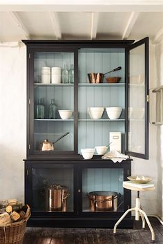 A free-standing glass front cabinet from DeVOL is a refreshing change from all of the built-ins. And I love the tong and groove inside painted in a pretty blue.