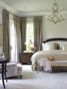 love this, corner windows, chandelier,big bed, sitting area, bench at foot of bed PERFECT
