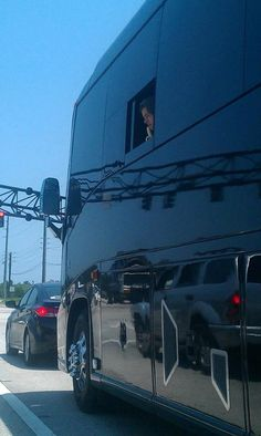 Harry decided to stick his head outside of the tourbus and eat a banana...