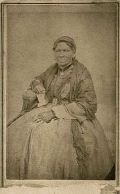 "June 28, 1863: While James sat on a porch in a thunderstorm, a female slave, who probably looked like the woman in this photograph, told him about the white Confederate sympathizers leaving the area. ""Aunt Sukey"" African American slave of Robert B. Smith family. Carte de visite by T.D. Saunders, Lexington, MO, ca. 1860. Missouri History Museum."