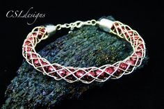 In this tutorial I show you how to make a hollow wirework kumihimo bracelet, with beads running along the inside of it. Please feel free to give it a go your...
