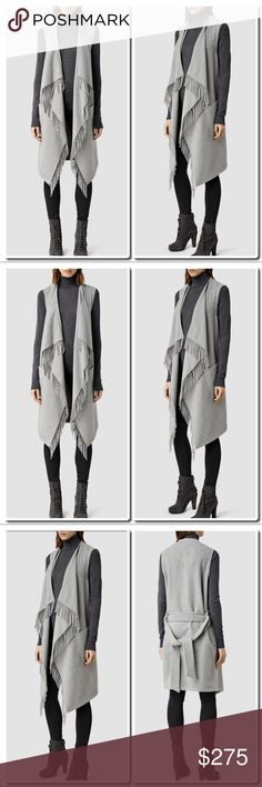 """CCO All Saints Paxton Sleeveless Coat in Pale Grey Make the transition through the seasons a seamless one in this chic knitted coat by AllSaints. This deconstructed style is designed with a open waterfall front and detailed with a tassel hem and a waist belt to close. Crafted from a cosy wool blend, this sleeveless unlined piece is perfect for layering. Wear yours over a roll neck top and pair with dark denim for off-duty chic.  Length Back 39"""" - longest point 45"""" 60%Wool 40% Polyester Blend…"""