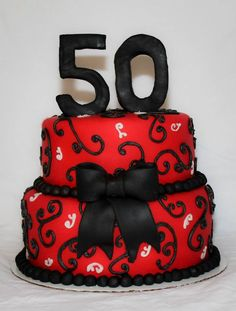 A 50th birthday cake idea for a man in red black silver See more