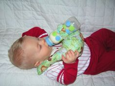 Possibly Make one of my own? Baby Bottle Holder Prop Pillow Twins Triplets by queenpartyof6