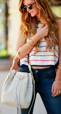 Stripped crop top, flared jeans, and Gigi New York bucket bag, casual spring outfit