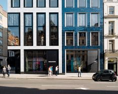 Architecture. 24 Savile Row. Facade sheathed in tiles by Kate Malone. Architect: EPR Architects.