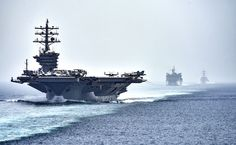 STRAIT OF HORMUZ (July 21, 2016) The aircraft carrier USS Dwight D. Eisenhower (CVN 69), followed by the fast combat support ship USNS Arctic (T-AOE 8) and the guided-missile destroyer USS Nitze (DDG 94), transit the Strait of Hormuz. The Eisenhower Carrier Strike Group is deployed in support of maritime security operations and theater security cooperation efforts in the U.S. 5th Fleet are of operations. (U.S. Navy photo by Mass Communication Specialist 3rd Class J. Alexander…