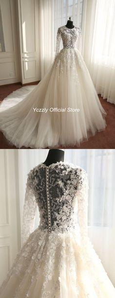 wedding dress#wedding dress long sleeves#wedding dress lace#A-line wedding dress#wedding dress beaded#wedding dress flowers#wedding gowns#bridal gown#bride dresses