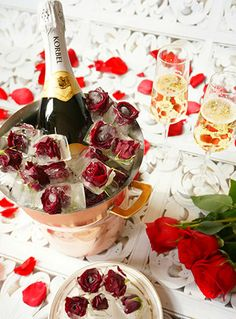 Harris Teeter - Valentine's DayChampagne Rose Ice Cubes  Really impress your Valentine this year! Dress up your champagne bucket with romantic rosebud ice cubes.  To make the ice cubes, detach small rose buds from the stem and place in silicone ice cube trays. Top off with water and freeze. Once solid, simply remove from the tray and top off your champagne bucket with these lovely cubes!  Making a cocktail? These would be gorgeous too!