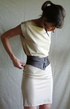 Simple, yet very chic, this demi-corset belt can be worn as shown, rather like a corset, or else with the closure off to one side, or even with the leather situated to be a little askance. There are so many ways to style this piece and I keep finding more outfits with which it looks sharp. Made to measure, using re-purposed leather with a smooth wooden pin closure. Indicate in the Message to Seller if you would like a black, brown or blond colored pin to close your demi-corset. If you…