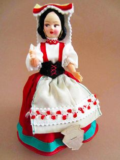 Pretty little lady from Roma, Italy. She wears a red skirt trimmed with a green ribbon, a white cotton shirt with a black felt corset and a cream Two Buns, Plastic Shoes, Green Ribbon, Red Skirts, Black Felt, Sell On Etsy, Red Shoes, Vintage Costumes, Headdress