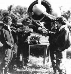 RABAUL pilots from the elite squadron tainan kokutai using a zero as shinto shrine
