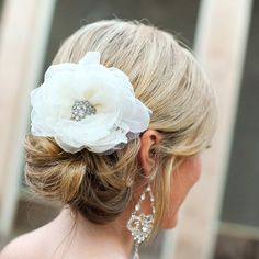 Fabric flower hairpiece // photo by: Agape House Studio // http://www.theknot.com/weddings/album/an-eco-friendly-wedding-in-houston-tx-110638