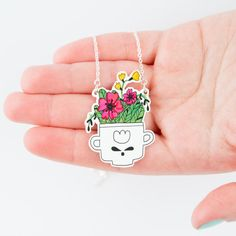 Flowers in The Teacup Necklace by andsmile on Etsy, £12.00