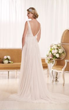 This lace embellished tulle over Lavish Satin vintage-inspired sheath bridal gown from the Essense of Australia wedding dress collection features a plunging neckline and sophisticated chapel train. The back zips up under crystal buttons. From petite to tall, thin to hourglass shaped, this exquisite dress flatters every body type.
