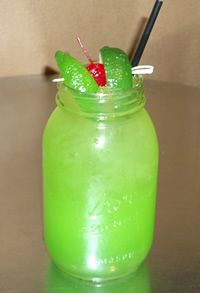 Toby Keith's Swamp Water Recipe!!!!! Sounds interesting!!!!!  Recipe For Swamp Water:  (prepare in mason jar over ice)    1.25 ounces – Wild Shot Silver  2.25 ounces – Apple Pucker  .75 ounces – Simple Syrup  Splash of Midori  Fill with Sweet & Sour Mix  Float lime juice, garnish with 2 limes and a cherry.  Add 2 drops of green food coloring to darken the green (optional)