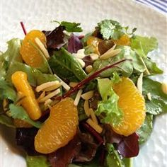 "Orange Almond Mixed Green Salad~~  ""This is a quick and easy salad idea with a homemade vinaigrette drizzled over a mixture of lettuce, mandarin oranges, and almond slivers."""