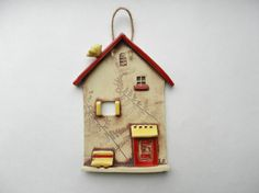 Hey, I found this really awesome Etsy listing at https://www.etsy.com/listing/185308768/ceramic-house-wall-hanging-clay-house