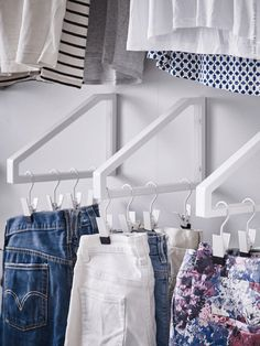 Little Life Savers: Clever IKEA Hacks for Small Spaces (Shelf brackets mounted upside down for hanging clothes!)