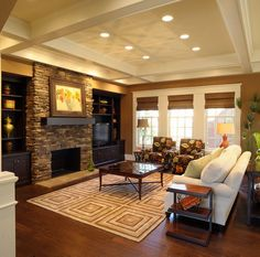 Warm caramel like living room with black and white accents, stone fireplace. Love.
