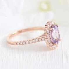 This large purple sapphire engagement ring in rose gold halo diamond ring is perfect for brides looking for non-traditional diamond alternative engagement rings! The lavender purple sapphire ring can nest with curved wedding bands as stacking ring wedding set. Adore her with this September birthstone sapphire ring! Stacked Wedding Rings, Matching Wedding Rings, Curved Wedding Band, Wedding Set, Wedding Bands, Diamond Ring Settings, Halo Diamond, Traditional Engagement Rings, Purple Sapphire