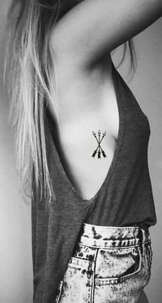 Meaningful Small Arrow Rib Tattoo Ideas for Women - ideas tribales del tatuaje para chicas - www.MyBodiArt.com