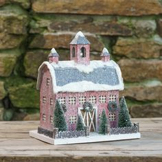 """Light up your Christmas village with this decorated paper putz dutch barn. - 7"""" L x 8"""" W x 13"""" H. - Pressed paper, batting, glitter, bottle brush trees. - Lights up with included light cord. - Importe"""