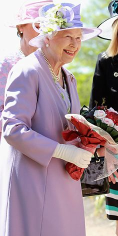Queen Elizabeth's Pretty in pastels! For a trip to the Floriade Flower Festival, Queen Elizabeth donned a monochromatic lilac look.