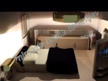 Room design by me.Underfloor closet and open book mirror when closed  a TV set corner.