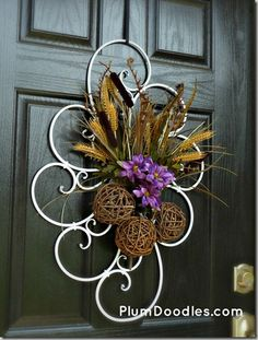 She hung a piece of scroll work on the door and attaches seasonal decorations to it.  Very unique and pretty.