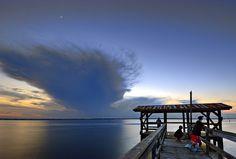 Fishermen at dusk on Mandarin's County Dock at Walter Jones Historical Park on the St. Johns River in Jacksonville, Florida.