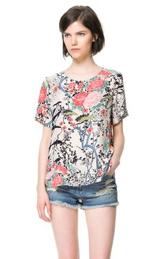 Bought this top this afternoon - will go perfect with my black and white striped skirt!