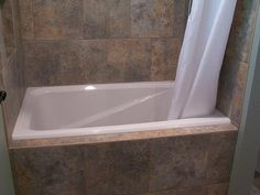 Soaking tub for small bathrooms intended to fit in a pre