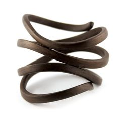 Bracelet |  Gustav Reyes. Walnut wood - all his work is beautiful and actually I prefer the single 'knot' bracelet