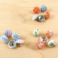 I pinned this Fabric Thumbtacks - Set of 75 from the Girl of All Work event at Joss & Main!   why not make them yourself!!