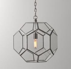 RH baby&child's Giles Faceted Sphere Lantern Pendant Pewter:Offering a streamlined take on the traditional oil lantern, our fixture features a geometric metal frame with clear glass panels and an ingenious hidden access point that allows for bulb changes.